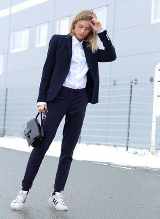 How to wear: white and black horizontal striped low top sneakers, navy dress pants, white dress shirt, navy blazer
