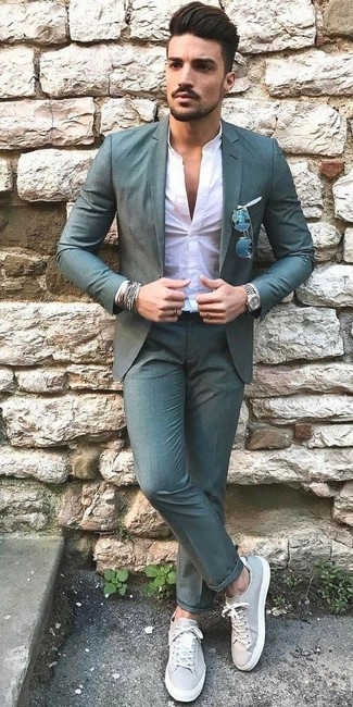 How to Wear Teal Dress Pants For Men: A teal blazer and teal dress pants are essential in a polished man's wardrobe. You can get a little creative on the shoe front and tone down your ensemble by finishing off with grey leather low top sneakers.