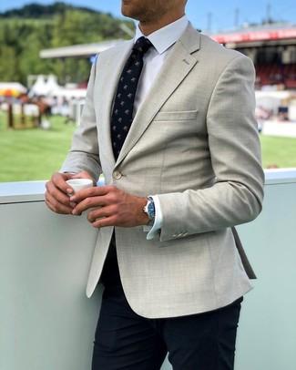 How to wear: navy print tie, navy dress pants, white dress shirt, beige blazer