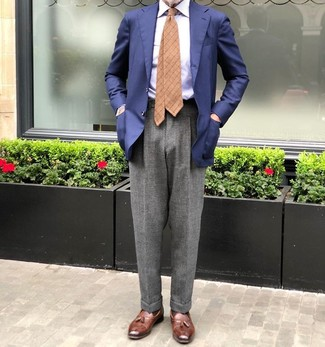 How to Wear a Light Blue Vertical Striped Dress Shirt For Men: For an outfit that's absolutely Bond-worthy, try pairing a light blue vertical striped dress shirt with grey wool dress pants. Introduce brown leather tassel loafers to the equation and you're all set looking incredible.