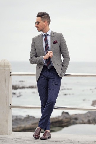 Men's Looks & Outfits: What To Wear In 2020: A grey wool blazer looks especially elegant when worn with navy wool dress pants for an ensemble worthy of a proper gent. Grab a pair of burgundy leather double monks et voila, the ensemble is complete.