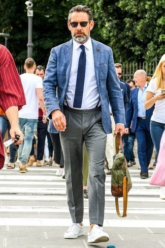 How To Wear a Dress Shirt With a Blazer For Men: This sophisticated combination of a blazer and a dress shirt will cement your styling expertise. For something more on the daring side to complement your look, go for a pair of white leather low top sneakers.