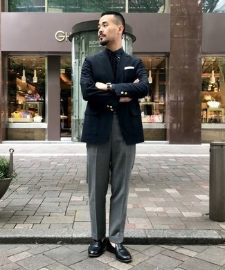 Men's Looks & Outfits: What To Wear In 2020: We love the way this combo of a black blazer and grey dress pants immediately makes men look sophisticated and sharp. If in doubt about the footwear, go with a pair of black leather loafers.
