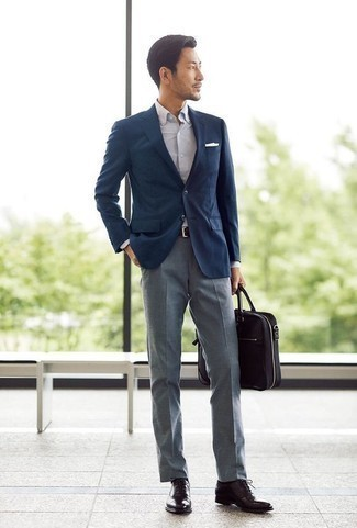 How to Wear Dark Brown Leather Oxford Shoes: Pair a navy blazer with grey dress pants to look like a proper gent with a good deal of style. Introduce a pair of dark brown leather oxford shoes to the mix et voila, the ensemble is complete.