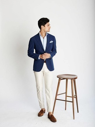 How to Wear a Light Blue Dress Shirt For Men: You can be sure you'll look smooth and stylish in a light blue dress shirt and white dress pants. A pair of brown suede loafers can effortlessly tone down an all-too-dressy look.