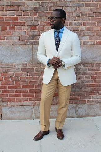 How to Wear a White Blazer For Men: You'll be amazed at how easy it is to put together this elegant getup. Just a white blazer paired with khaki dress pants. When in doubt about what to wear when it comes to shoes, go with brown leather derby shoes.
