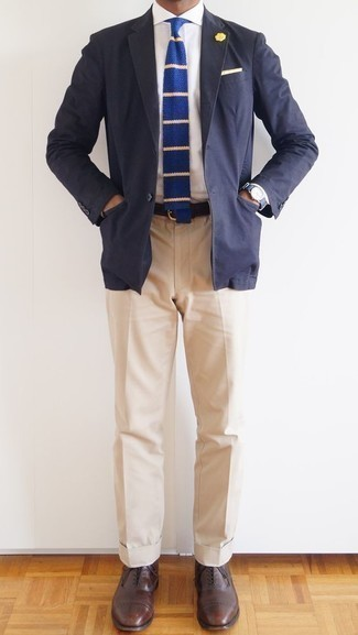 How to Wear Beige Dress Pants For Men: Dress in a navy blazer and beige dress pants and you'll look like a true style maven. The whole ensemble comes together when you complete this ensemble with a pair of brown leather oxford shoes.