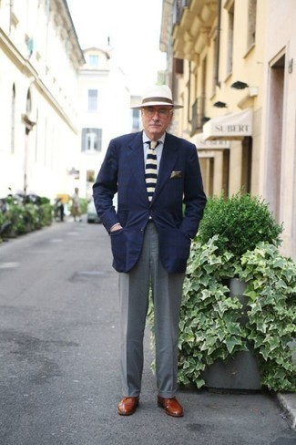 Fashion for Men Over 60: What To Wear: Pair a navy blazer with grey dress pants for rugged elegance with a fashionable spin. Tobacco leather desert boots will give a playful vibe to your outfit. This one is a modern but also age-appropriate combo for a gent in his sixties.