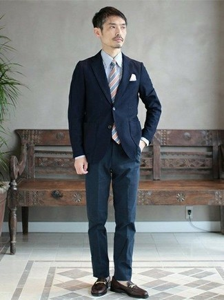 How to Wear a Navy Blazer For Men: This combination of a navy blazer and navy dress pants is a tested option when you need to look truly sharp and sophisticated. Black leather loafers are a never-failing footwear option here that's full of character.
