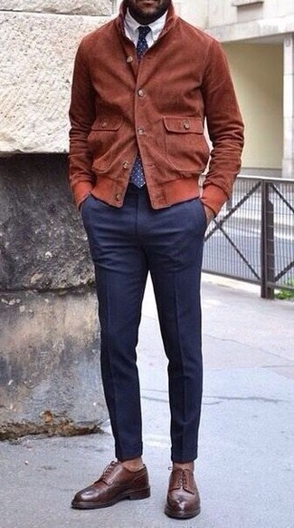How to wear: dark brown leather derby shoes, navy dress pants, white dress shirt, tobacco suede bomber jacket
