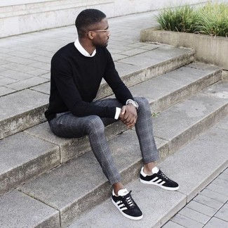 How to wear: black and white suede low top sneakers, grey plaid dress pants, white dress shirt, black crew-neck sweater
