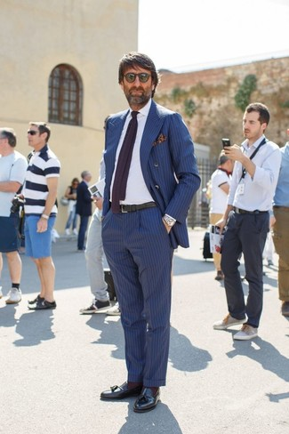 How to wear: black leather tassel loafers, blue vertical striped dress pants, white dress shirt, blue vertical striped double breasted blazer