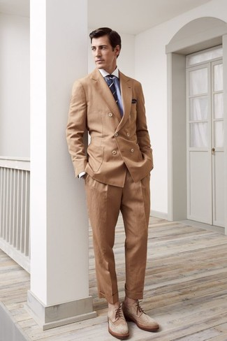 How to wear: tan suede brogue boots, khaki dress pants, light blue dress shirt, tan double breasted blazer