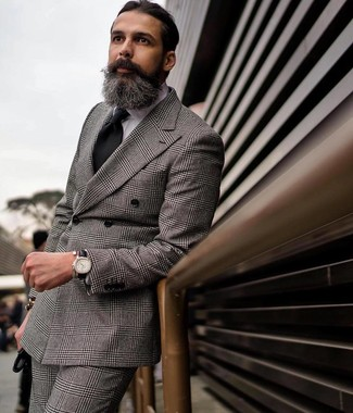 How to Wear a Grey Plaid Double Breasted Blazer For Men: This elegant combo of a grey plaid double breasted blazer and grey plaid dress pants is a must-try getup for any modern man.