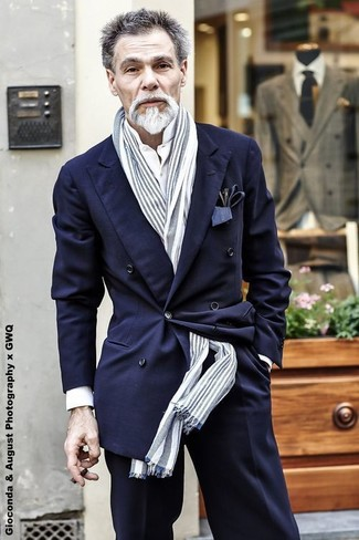 How to wear: grey vertical striped scarf, black dress pants, white dress shirt, navy double breasted blazer