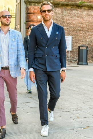 How to Wear a Navy Double Breasted Blazer For Men: Pairing a navy double breasted blazer with navy dress pants is an on-point choice for a dapper and classy getup. Take a more casual approach with footwear and add a pair of white leather low top sneakers to the mix.