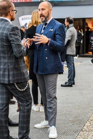 How to Wear Blue Horizontal Striped Socks For Men: Putting together a navy double breasted blazer with blue horizontal striped socks is an awesome option for a casually cool outfit. A pair of white leather low top sneakers is a great choice to complete your look.
