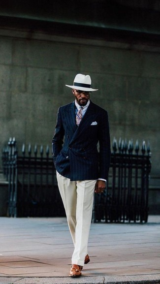 How to Wear a Blue Paisley Tie For Men: A navy vertical striped double breasted blazer and a blue paisley tie are among the unshakeable foundations of any well-edited menswear collection. When it comes to shoes, this getup pairs wonderfully with tobacco leather tassel loafers.