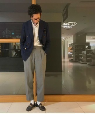 Men's Looks & Outfits: What To Wear In 2020: This is irrefutable proof that a navy double breasted blazer and grey dress pants look amazing when worn together in an elegant look for a modern guy. Want to play it down in the shoe department? Complete your getup with a pair of dark brown leather loafers for the day.