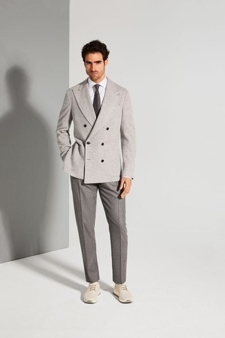 How to Wear Grey Dress Pants For Men: You're looking at the hard proof that a grey double breasted blazer and grey dress pants look awesome when married together in a classy ensemble for today's man. Finish off with a pair of beige athletic shoes to power up this outfit.