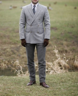 How to Wear a Double Breasted Blazer For Men: A double breasted blazer and grey dress pants are robust sartorial weapons in any modern man's arsenal. To give your outfit a more relaxed touch, complement this look with a pair of burgundy leather casual boots.
