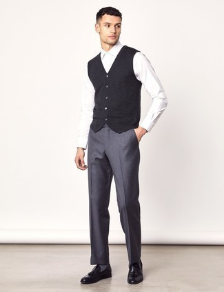 How to Wear Grey Wool Dress Pants For Men: Reach for a charcoal sweater vest and grey wool dress pants for a sleek polished outfit. For something more on the daring side to finish off this outfit, slip into a pair of black leather tassel loafers.