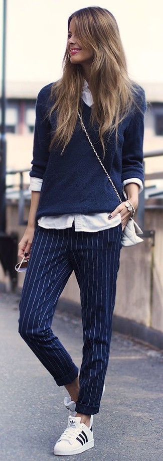 How to wear: white low top sneakers, navy vertical striped dress pants, white dress shirt, navy v-neck sweater