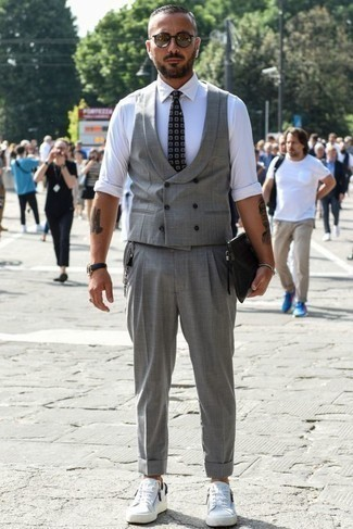 How to Wear a Black Print Tie For Men: Pair a grey waistcoat with a black print tie and you'll look like a true fashion expert. Finishing with white canvas low top sneakers is the simplest way to bring a touch of stylish effortlessness to this ensemble.