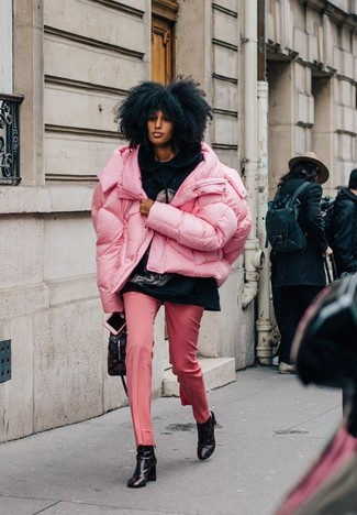 How to wear: black print leather ankle boots, pink dress pants, black print hoodie, pink puffer jacket