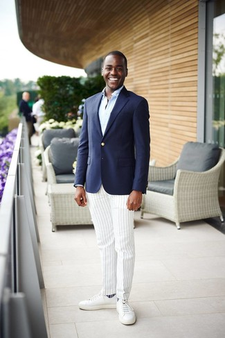 How to wear: white leather low top sneakers, white vertical striped dress pants, light blue long sleeve shirt, navy blazer
