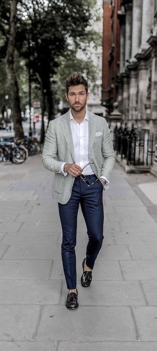 How to Wear a Grey Blazer For Men: Channel your inner Bond and dress in a grey blazer and navy vertical striped dress pants. Complement your getup with a pair of dark purple leather tassel loafers and the whole getup will come together.