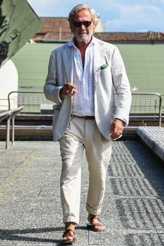 How to Wear a White Blazer For Men: Undeniable proof that a white blazer and beige dress pants are amazing when married together in a refined getup for a modern gentleman. For something more on the daring side to finish off your look, throw a pair of brown leather sandals in the mix.