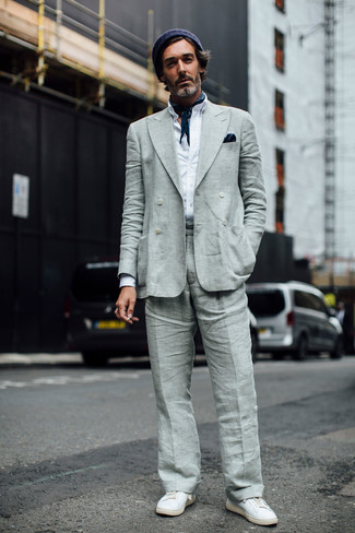 How to wear: white leather low top sneakers, grey linen dress pants, white long sleeve shirt, grey linen double breasted blazer