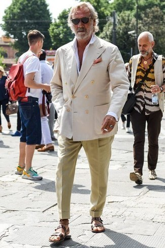 Men's Looks & Outfits: What To Wear In Summer: Wear a beige double breasted blazer with khaki dress pants if you're aiming for a proper, fashionable ensemble. To give your overall look a more casual twist, complete your ensemble with a pair of dark brown leather sandals. This outfit is ideal when it's super hot outside.