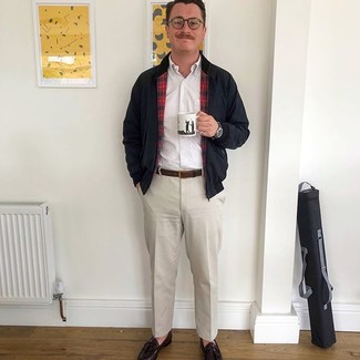 How to wear: dark brown leather tassel loafers, beige dress pants, white long sleeve shirt, black harrington jacket