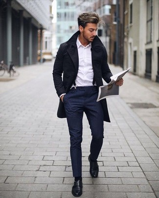 How to Wear a Black Trenchcoat For Men: Wear a black trenchcoat with navy vertical striped dress pants and you're bound to make a fashion statement. Introduce a pair of black leather double monks to your ensemble et voila, the look is complete.