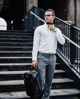 How to wear: black leather backpack, grey dress pants, white long sleeve shirt, navy turtleneck