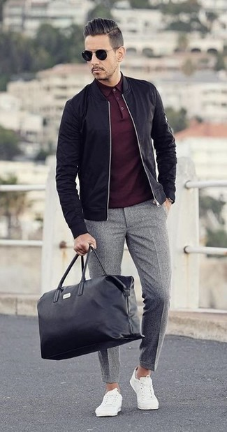 How to wear: white low top sneakers, grey wool dress pants, burgundy polo, black bomber jacket