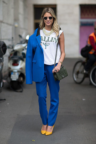 If you're scouting for a casual yet chic getup, wear a blue blazer with blue dress pants. Both garments are totally comfy and will look fabulous paired together. For shoes, opt for a pair of mustard leather pumps.