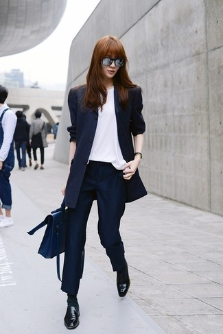 How to Wear Navy Vertical Striped Dress Pants For Women: This pairing of a navy vertical striped blazer and navy vertical striped dress pants is clean, absolutely chic and very easy to recreate! Complete your getup with a pair of black leather loafers and you're all set looking spectacular.