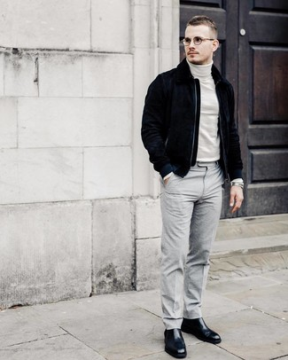 How to wear: black leather chelsea boots, grey dress pants, white turtleneck, navy suede bomber jacket