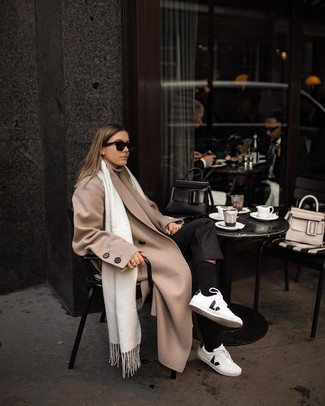 How to wear: white and black leather low top sneakers, black dress pants, beige turtleneck, beige coat