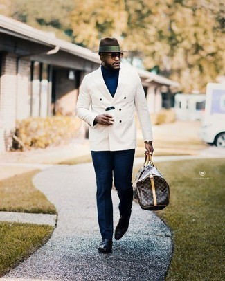 How to Wear a Gold Watch For Men: When comfort is top priority, this combo of a white double breasted blazer and a gold watch is a no-brainer. Black leather loafers add a refined aesthetic to the look.