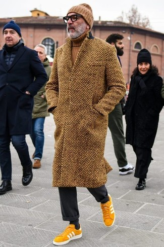 How to wear: mustard suede low top sneakers, black dress pants, brown turtleneck, brown herringbone overcoat