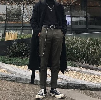 How to wear: black and white canvas low top sneakers, olive dress pants, black turtleneck, black overcoat