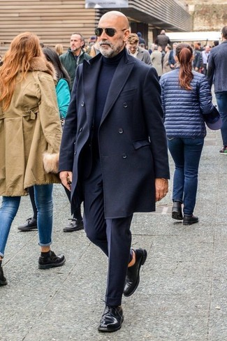 How to wear: black leather derby shoes, navy vertical striped dress pants, navy turtleneck, black overcoat