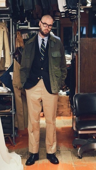 Men's Looks & Outfits: What To Wear In 2020: Wear an olive barn jacket with khaki dress pants to look like a proper gentleman. Complement your look with a pair of black leather derby shoes and ta-da: the getup is complete.