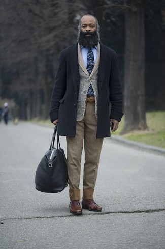 How to Wear a Navy Overcoat: Marrying a navy overcoat and khaki chinos is a surefire way to inject an elegant touch into your closet. Get a bit experimental in the shoe department and introduce a pair of brown leather derby shoes to the equation.