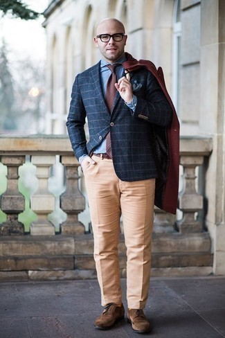 How to Wear a Coat For Men: A modern gentleman's polished collection should always include such essentials as a coat and khaki dress pants. Dial up the classiness of your look a bit with brown suede brogues.