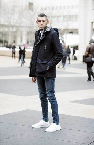 How to Wear a Navy Parka For Men: This combination of a navy parka and blue jeans is undeniable proof that a straightforward casual ensemble can still look really interesting. We're totally digging how a pair of white canvas low top sneakers makes this outfit complete.